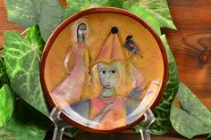 This Pillin dish has a beautiful hand painted scene wth 2 women and a horse. One woman is dressed as a Damsel. Perfect decorator piece and can easily be mounted within a frame or shadow box. The dish is a Yellow And Brown, Beautiful Hands, Shadow Box, Mid-century Modern, Decorative Plates, Mid Century, Scene, Pottery, Hand Painted