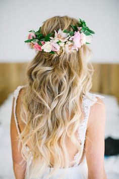 Beach wave boho chic hairstyle with the perfect flower crown: http://www.stylemepretty.com/little-black-book-blog/2017/01/03/colorful-surf-lodge-wedding-in-montauk/ Photography: Betsi Ewing - http://betsiewing.com/