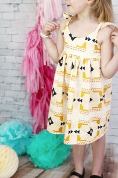 This is the perfect sundress for the summer holidays. It has a beautiful fitted bodice and thin frilly straps.