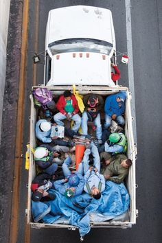 From his morning-time perch above the southbound lanes of Highway 85 in Monterrey, Mexico, photographer Alejandro Cartagena catches images of people on their way to work