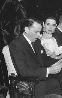 "Gloria Vanderbilt  with Frank Sinatra at the opening of ""Pajama Game"" on Broadway in 1954, the year she divorced Stokowski."
