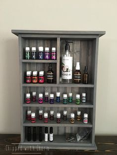 Essential Oil Storage Shelf  This cabinet is the perfect way to display your Essential Oils while keeping them safe and organized. Our design features an arrangement of shelving that will fit all of your oil bottles and supplies. The shelves are deep enough to comfortably accommodates 3 5ML YL bottles or 2 15ML YL bottles.  This shelf has been stained and sealed to help protect and preserve the beauty of this piece for years to come.  Approx. cabinet dimensions: at largest points 26 1/4 ...