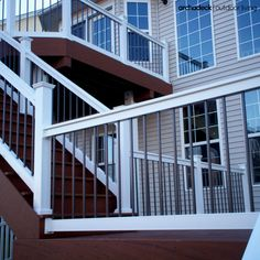 We LOVE the color contrast seen in this multilevel deck designed with rich dark decking, bright white rails and brushed metallic balusters. | west-county.archadeck.com