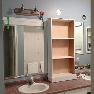 large bathroom mirror redo to double framed mirrors and cabinet, bathroom ideas, home decor, shelving ideas, middle cabinet in place new light fixtures connected and now onto the framing of the mirrors uniquebathroommirrors Bathroom Mirror Makeover, Large Bathroom Mirrors, Bathroom Mirror With Shelf, Large Bathrooms, Small Bathroom, Master Bathroom, Framed Mirrors, Bathroom Ideas, Modern Bathroom