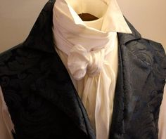 This is a cravat which would have been in style for men in the victorian era. He would wear this under his cutaway coat.