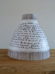 ikea melodi lamp hack - write favorite poem, verse, or book excerpt on lampshade with permanent marker.
