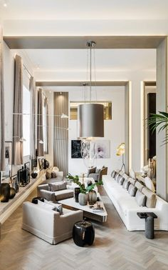 Soaring double-height ceilings and a bank of windows – along with Kelly's signature palette – make her living room airy and bright | Inside interiors queen Kelly Hoppen's spectacular home