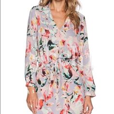Shein long sleeve floral dress Shein long sleeve floral dress that cinches at the waist. Hits me right above the knee. I wore it to my brother's graduation. Can definitely dress it up or down! Shein Dresses
