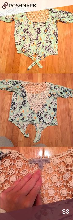 Charolette russe crop top that ties on the bottom The back of the shirt is open. In decent condition and only worn a few times. It is a little bit longer than a crop top but doesn't not cover entire stomach/waist. Charlotte Russe Tops Crop Tops