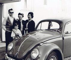 No, this is not James Dean and his family. This is how casually elegant people looked in the German province in 1962. The Volkswagen Beetle was one of the most popular cars at the time and back then its round shapes were the most common sight on European streets.