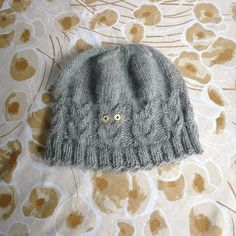 P1030326 by eudyptula48, via Flickr.  Cute hat with cabled  owls!  Free pattern.  I need to make this