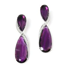 Rina Limor- Lovely Amethyst earrings styles with a twist of Diamond accents. So luxe and eye-catching for a perfect finish to your party look. Earrings set in 18K white gold. Dia 0.55ctw Amethyst 28.63cts