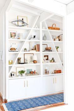 Gorgeous, breezy bookshelf styling by Emily Henderson.