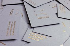 Business cards that utilises grey paper and boards with gold foil print finish for Oslo-based furniture, interior and architecture studio Krohn designed by Commando Group.