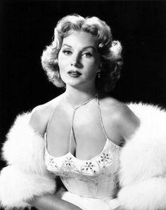Um....look at that neckline!  Wow.  Rhonda Fleming in quite a dress! (comment courtesy previous pinner)