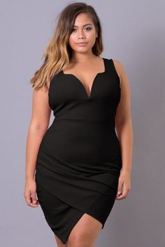 This plus size, stretch-knit dress features a plunging neckline with wire support and surplice front. Content + Care - 96% Polyester 4% Spandex - Machine Wash Cold Model Measurement - Wearing a Size 1