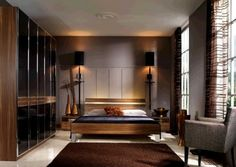 Master Bedroom - Exquisite with sophisticated tones elegantly harmonized creating dramatic moods. just a different man chair