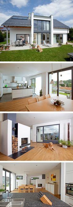 Satteldach Haus modern mit Querhaus, Galerie & Kamin - Einfamilienhaus Baumeister Haus Leitner Massivhaus bauen - HausbauDirekt.de