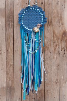 Dream Catcher made of vintage laces, buttons and real seashells. A dreamcatcher for your baby boy nursery decor, wedding decor, blue wedding decor and of course for ypur beach house decor !