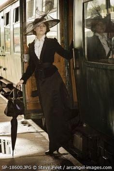Edwardian Period Woman's Fashion. Train travel .© Steve Pete / arcangel-images.com
