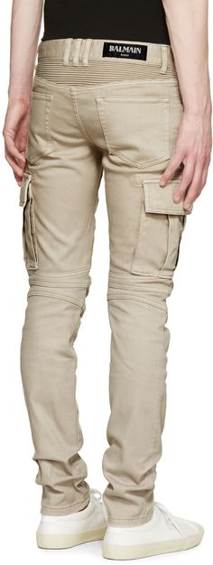 Slim-fit cotton cargo pants in beige. Five-pocket styling with zippered welt pockets at front.  Ribbed panelling at back waist and knees. Flap pockets at sides. Silver-tone hardware. Tonal stitching.