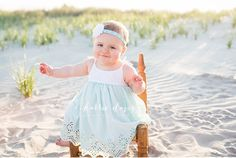 Photo of cute baby sitting on chair at a beach in New Jersey for family pictures