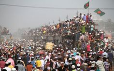 People gesture from train after the end of the World Muslim Congregation, also known as Biswa Ijtema, at Tongi, on the outskirts of the Bangladesh capital Dhaka