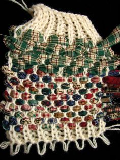 tutorial. knit weaving to make rag rugs on the knitting machine.  She suggests using 1/4″ strips of felted wool….basically like thick yarn.