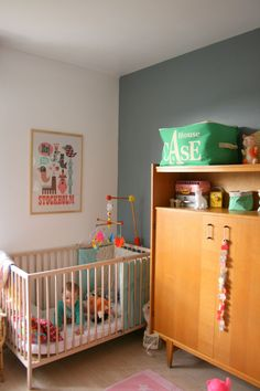An adorable nursery.  love the wardrobe and the grey wall.