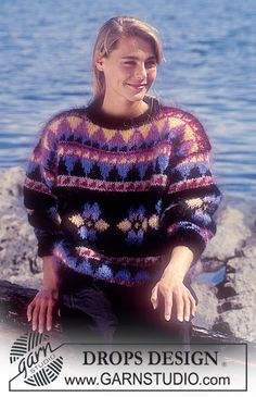 """DROPS 28-9 - DROPS jumper with pattern borders in """"Vienna"""". - Free pattern by DROPS Design"""