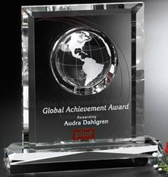 A flawless optical rectangle with reflective beveled edges combined with an optical globe creates a stunning award.