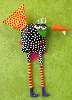 Made from up-cycled fabrics, sewn into fun critters, stuffed with plastic bags…