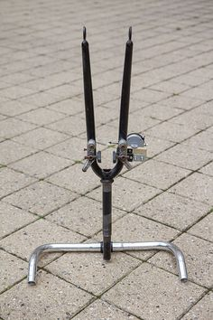 A homebuilt truing stand for bicycle wheels made from an old frame and wooden blocks Bicycle Wheel, Bike, Wrench Sizes, Old Frames, Wooden Blocks, Metal Bands, The Struts, Pump, Cycling