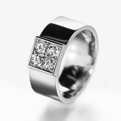 Big, bold, and beautiful. This band has all these qualities and more. This lovely unisex band makes the perfect engagement ring or wedding band for the modern, sophisticated person in your life. Four (4) white diamonds are used to form a center square in this ring. Each diamond bounces