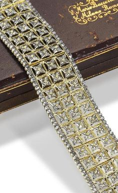 A diamond-set bracelet, by Buccellati, circa 1930. The highly articulated strap