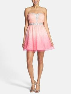 Too cute! Love this sparkly pink ombré fit and flare dress for prom.