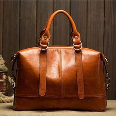 Designer Strap Decorated Top Handle Leather Handbag