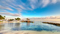 """If blue skies and tan lines seem like a distant memory, a quick <a href=""""http://www.travelchannel.com/destinations/caribbean"""">Caribbean</a> vacation may be what you're craving. Consider the Bahamas, a chain of more than 700 islands, cays and reefs, which will feel downright balmy compared with East Coast temps. This year-round island paradise just off the Florida coast is in its peak season, allowing you to choose to splurge on a luxurious resort with all the trappings at Atlantis Paradise…"""