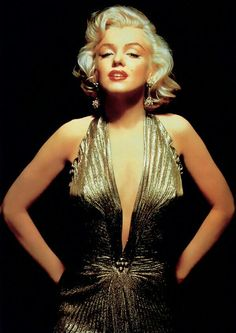 """In this undated publicity photo courtesy Running Press, Marilyn Monroe is shown wearing a knife-pleated gold lamé gown made from """"one complete circle of fabric."""" She wore this dress in """"Gentlemen Prefer Blondes."""" Monroe passed away a half-century ago Marylin Monroe, Fotos Marilyn Monroe, Marilyn Monroe Poster, Glamour Hollywoodien, Old Hollywood Glamour, Classic Hollywood, Hollywood Jewelry, Hollywood Star, Hollywood Cinema"""