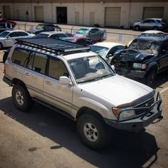 This clean 100 series land cruiser is ready to go home with its new #frontrunneroutfitters slim line II roof rack, light bar and spare tire step.