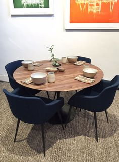 """Solid American walnut. Matte oil finish. Spun iron base with black powdercoat. Adjustable floor glides. Available in two diameters: 40"""" and 47"""". 28.5"""" h. Shown with Indigo Armchair. Please allow appro"""