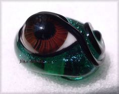 Love the detail!! Jinx Garza Lampwork Dichroic Green Glass Brown Evil Eye Bead 20604
