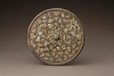Bronze mirror with turquoise and seashell inlays, Tang Dynasty AD);