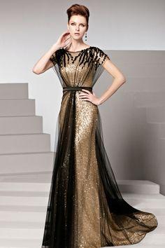 Robe dorée tulle noir pailletée ceinturée ornée de rhinestones