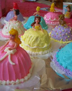 How to make Individual Princess Cupcakes ~ turn cupcake upside down, add small plastic princess' and then decorate as you wish