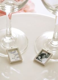 Decorate your wine glasses with these photo frame wine charms. A perfect way to add a personal touch to any gathering.  Features and Facts:  Each silver frame charm fits a photo that