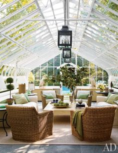 This greenhouse turned pool cabana was designed by Timothy Corrigan for a home in Lake Forest, Illinois.