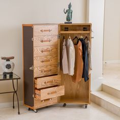 The entire piece is built on black wheels for a more mobile approach to storage. This rolling wardrobe exudes a traditionally trendy feel with acute attention to its stud detailing while remaining not only impressive but also functional.