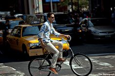 stylish men on bike during Fashion Week