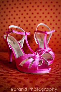 I think BOLD colored shoes are awesome for the bride to wear. I wore these hot pink ones at mine! :-)